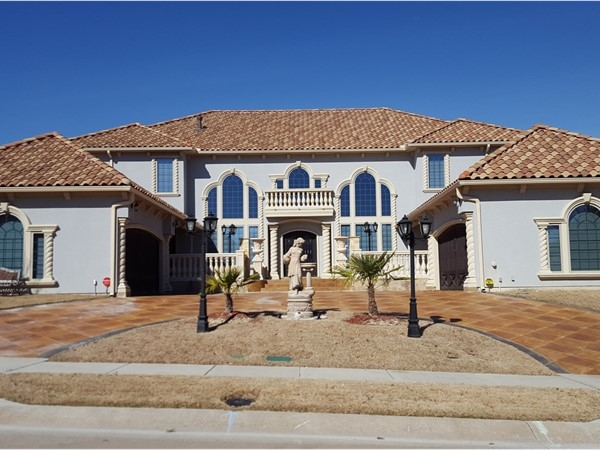 A Spanish style home in The Bluffs At Winding Creek