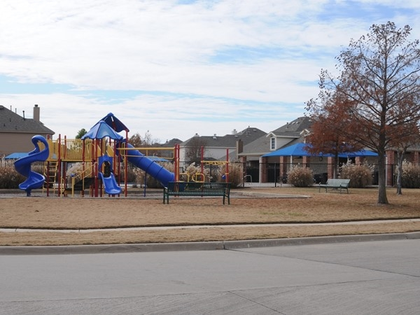 Neighborhood playground and pool at Villages of White Rock Creek